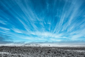 An Icelandic Morning — Cloud Formations over Mountains and Snow-dusted Lava Field