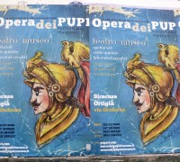 Poster promoting a traditional puppet show in Ortigia